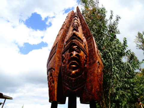 Shoulders of vision and hope Sculpture: Wood 320 x 121 cm (H x W) 467 Kgs, Weight Inspired by the faces of Kenya. borrows from the coastal totem figures. Carved in African teak. The piece stands at the Jomo Kenyatta International Airport (JKIA) KQ departure terminal in Nairobi, Kenya. Hollow wood joinery. Style: Semi abstract Theme: Cultural african sculpture art by Kenyan artist based in Nairobi.