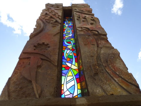 Looking up Sculpture: Fibre glass reinforced concrete Created in fibre glass reinforced concrete. Used stained glass for branding. Porte cochere piece. Style: Relief Theme: Celebration african sculpture art by Kenyan artist based in Nairobi.