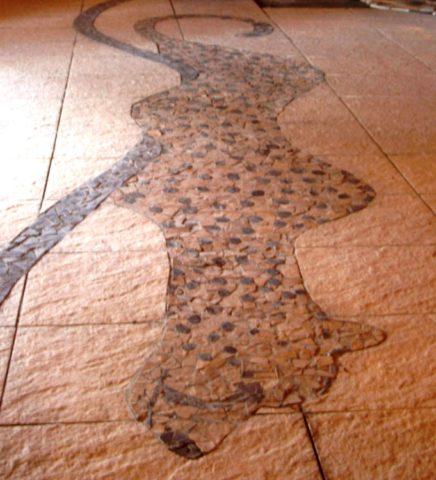 Keekorok 1 Mosaic: Granito tiles Created at the main entrance of Keekorok lounge, Maasai Mara. Kenya. Style: Stylised Theme: Branding african mosaic art by Kenyan artist