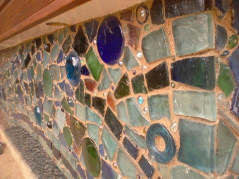 The River Mosaic: Dale blocks Garden pool bar . Sand grouting. River pebbles. Kitengela glass dale blocks. Style: Stylised Theme: Nature african mosaic art by Kenyan artist