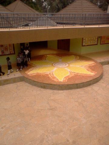 Sun Mosaic: Granito tiles Sunflower the sun symbol. Installed at St. Christopher school Karen, Nairobi. Style: Stylised Theme: Illuminate african mosaic art by Kenyan artist